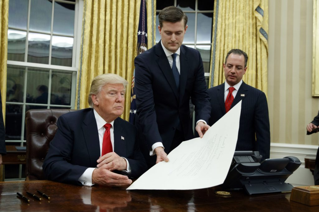 White House Staff Secretary Rob Porter center President Donald Trump and Chief of Staff Reince Priebus in January 2017