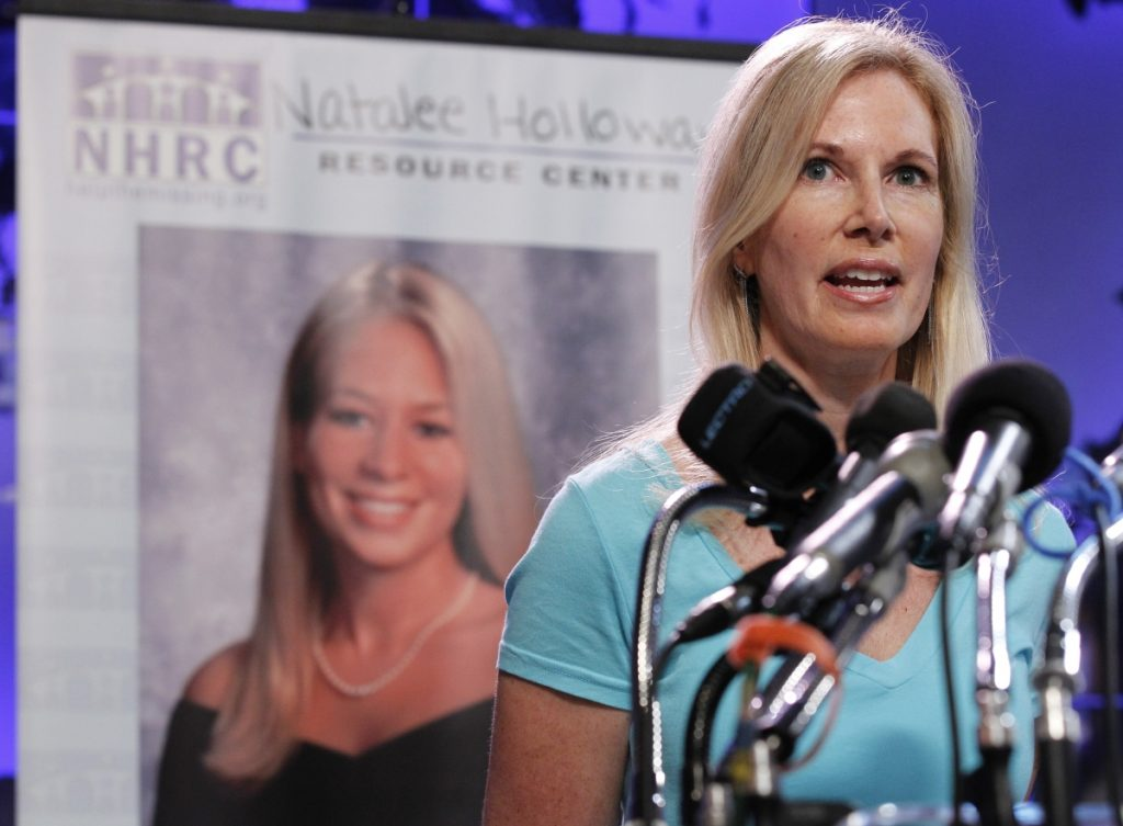 Beth Holloway, mother of Natalee Holloway, the teen missing since a trip to Aruba in 2005, has sued producers of a television show about her disappearance.