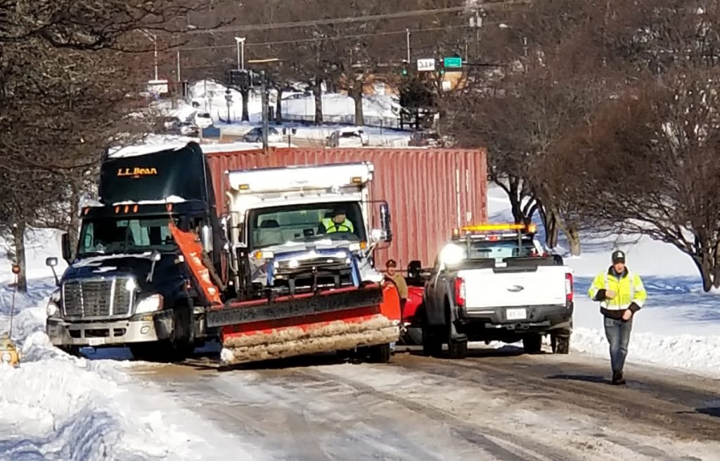 City crews work to free a tractor-trailer that got stuck across Franklin Street in Portland after it spun on ice on Thursday. Traffic was backed up for the morning commute, but was flowing freely by 9:15 a.m.