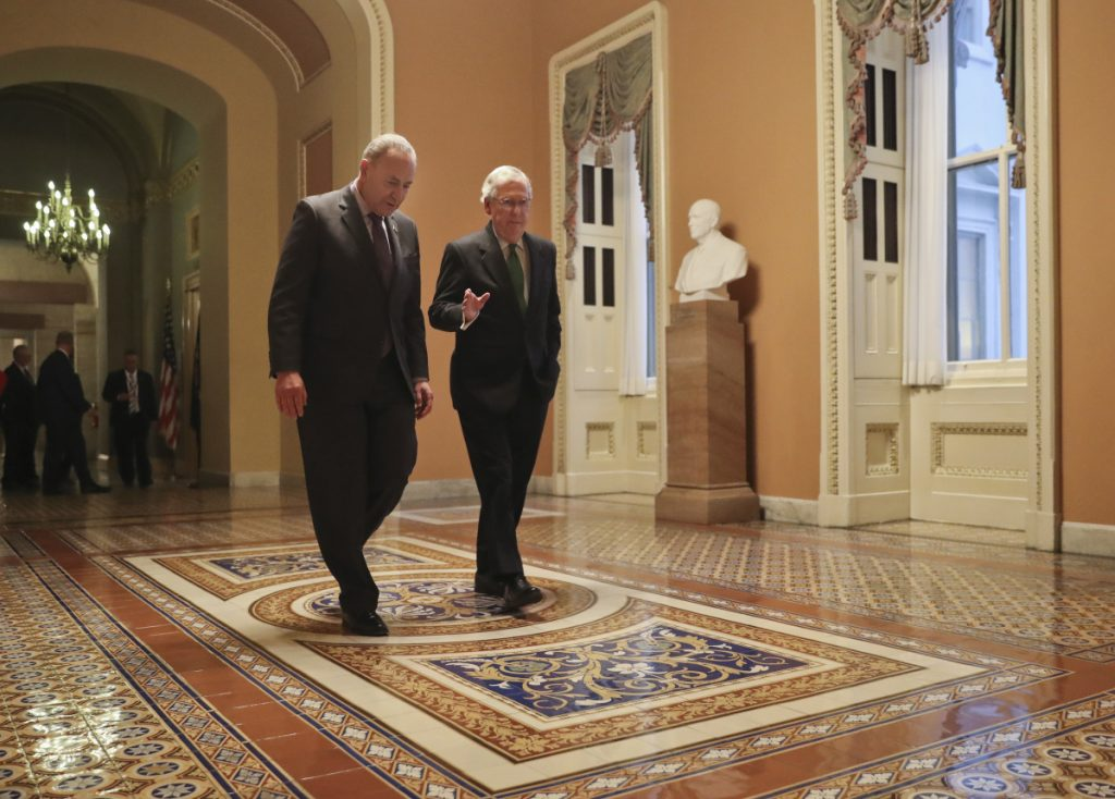 Senate Majority Leader Mitch McConnell R-Kentucky and Senate Minority Leader Chuck Schumer D New York left walk to the chamber after collaborating on an agreement in the Senate on a two-year almost $400 billion budget deal that would provide Pentago