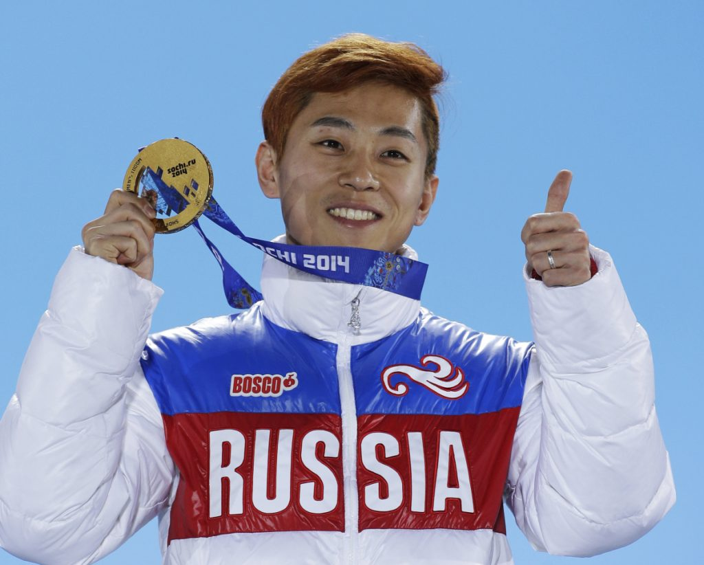 Viktor Ahn of Russia holds his gold medal at the 2014 Winter Olympics in Sochi, Russia. Ahn is among 45 Russian athletes and two coaches who were banned from the Pyeongchang Olympics because of doping concerns in a decision announced Friday, less than nine hours before the opening ceremony.