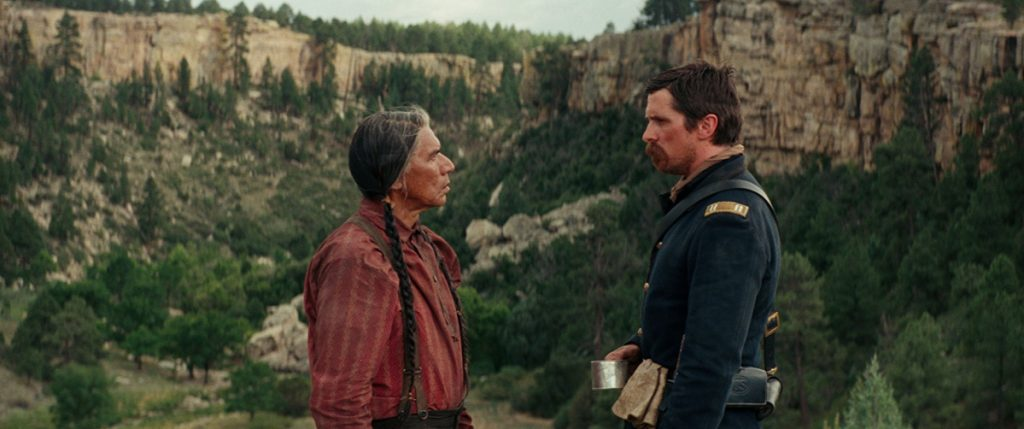 Wes Studi, left, and Christian Bale in