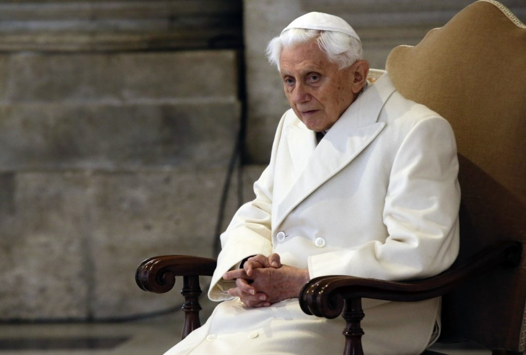 Pope Emeritus Benedict XVI attends a Mass at St. Peter's Basilica in 2015 on the fifth anniversary of his historic decision to retire