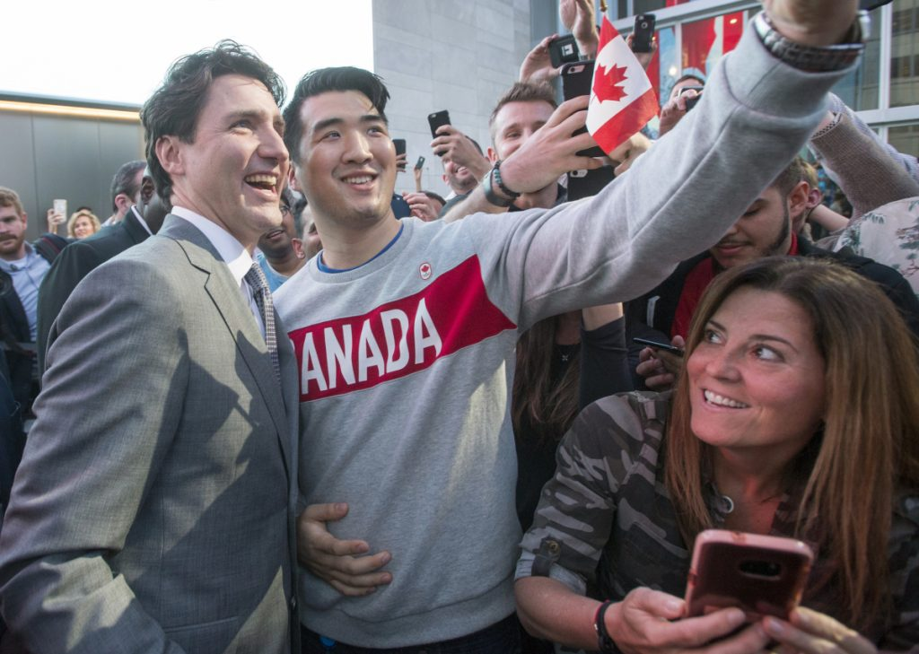 Canadian Prime Minister Justin Trudeau poses with employees as he leaves the offices of Salesforce on Thursday in San Francisco. It was the state leader's first official visit to California's tech-industry hub.