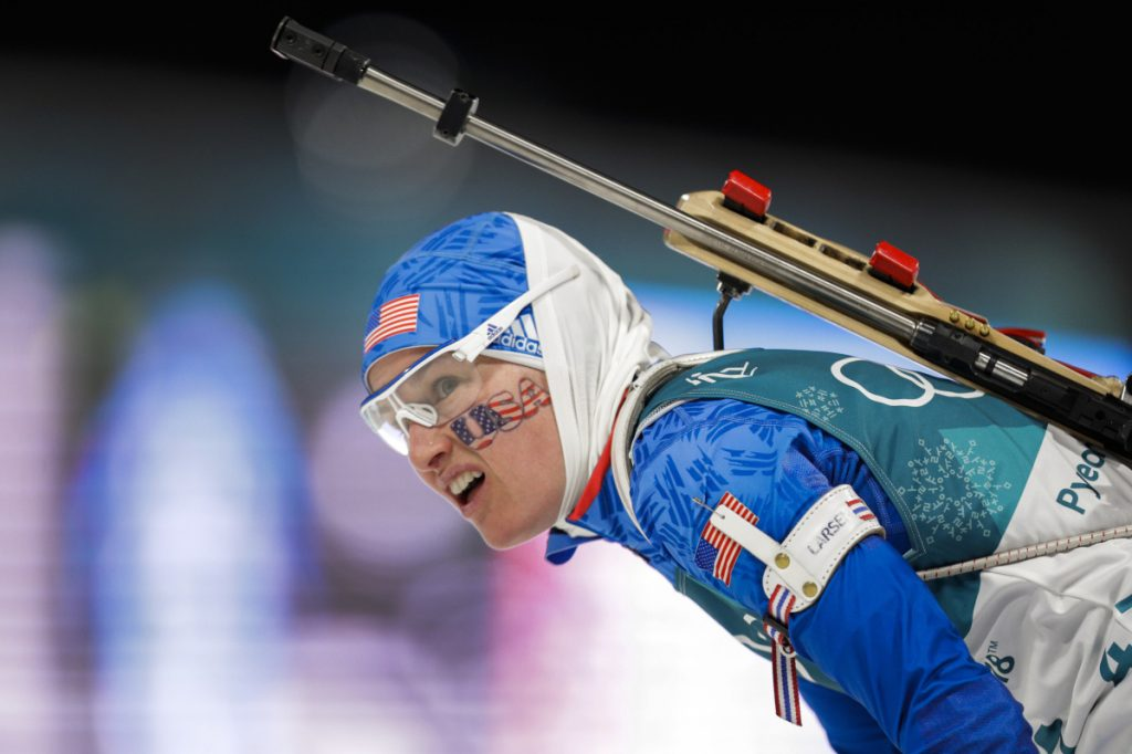 Clare Egan looks at her time after crossing the finish line during the women's 7.5km biathlon sprint at the 2018 Winter Olympics in PyeongChang, South Korea on Saturday.