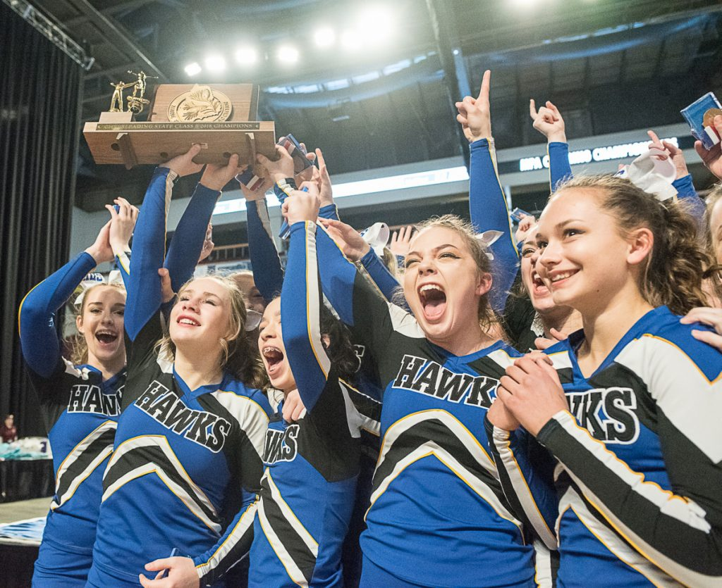 Hermon cheerleaders celebrate after receiving the championship trophy following their victory in the Class B state championships Saturday in Bangor. (Andree Kehn/ Sun Journal)
