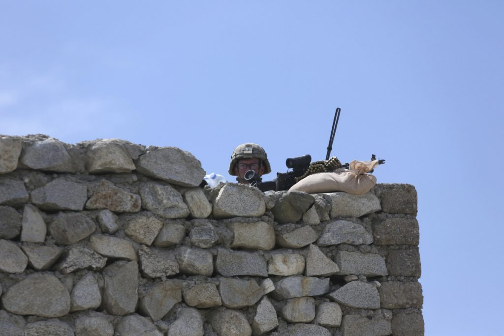 A U.S. soldier stands guard in the Achin district of Jalalabad, Afghanistan, last year. The U.S. military is expanding its efforts toward the eastern border, where the Taliban has commingled with ethnic Uyghur militants.