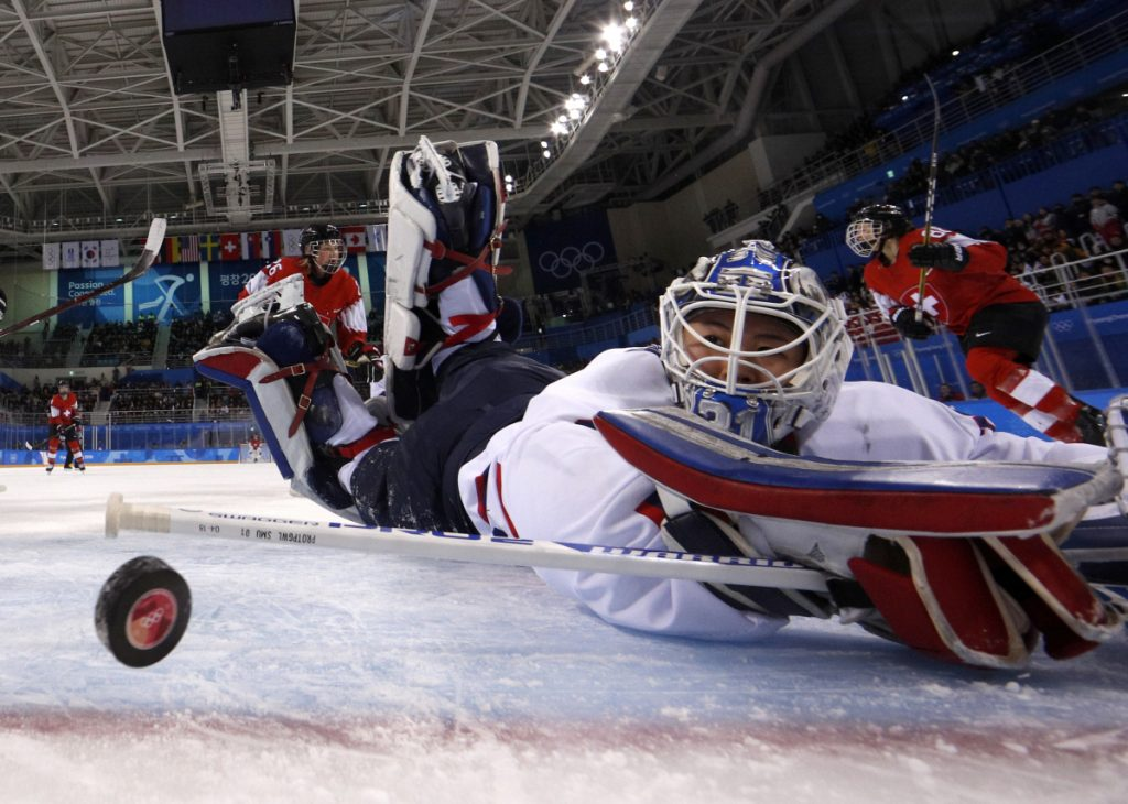 South Korea's goalie Shin So-jung, of the combined Koreas team, watches the puck go into the goal off a shot by Phoebe Staenz, of Switzerland, during the second period of a preliminary round game at the 2018 Winter Olympics in Gangneung, South Korea on Saturday.