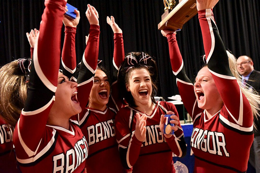 Bangor cheerleaders celebrate their victory Saturday in the Class A state championships at Cross Insurance Center. (Andree Kehn/Sun Journal)