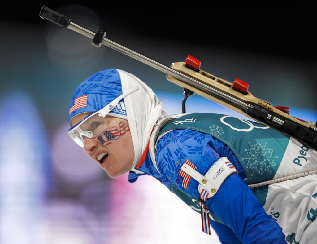 Clare Egan looks at her time after finishing the 7.5-kilometer biathlon sprint Saturday in PyeongChang, South Korea. Egan hit seven of 10 targets and was 2:45.4 behind winner Laura Dahlmeier of Germany.
