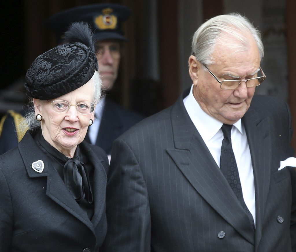 Queen Margrethe of Denmark and her husband, Henrik, leave the funeral service for Prince Richard of Sayn-Wittgenstein-Berleburg, in Bad Berleburg, Germany, March 21, 2017.