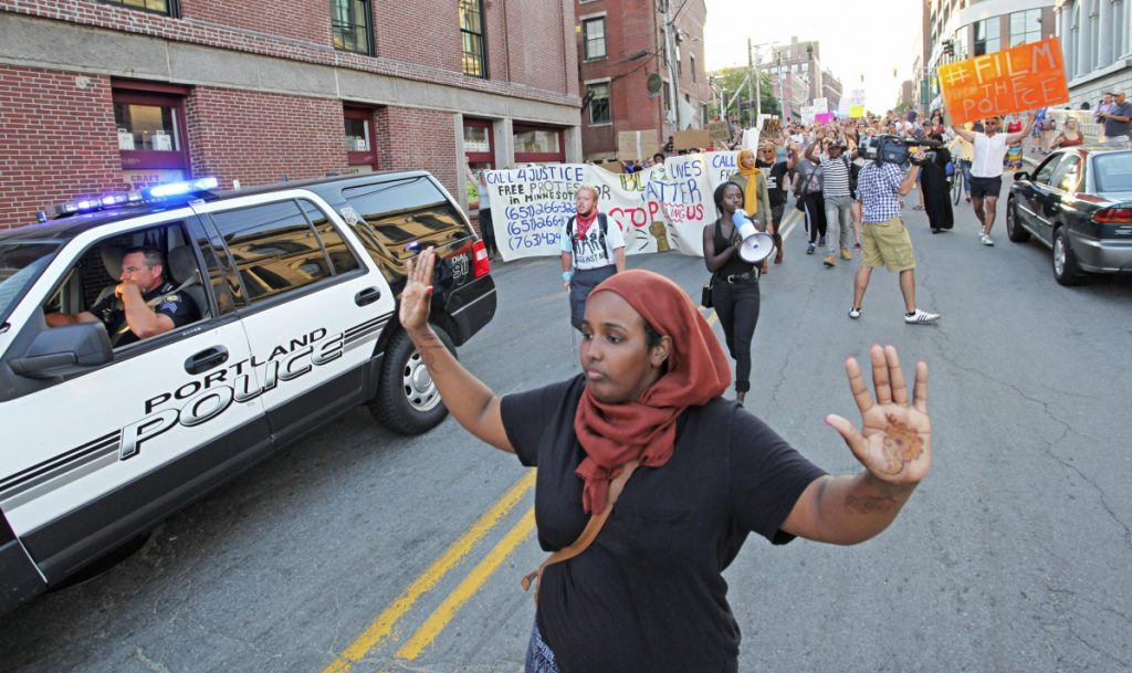 "Shadiyo Hussain chants ""Hands up, don't shoot!"" in 2016 during a march to a Black Lives Matter event in Portland. Asked to face up to our nation's endemic racism, white Americans often react as if the request is personal."