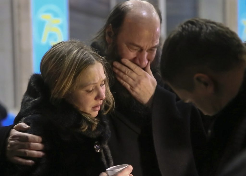Relatives and friends of those on the Saratov Airlines plane that crashed near Moscow's Domodedovo airport comfort each other while gathering at an airport outside Orsk, Russia, on Sunday, after hearing that the passenger plane went down shortly after taking off.