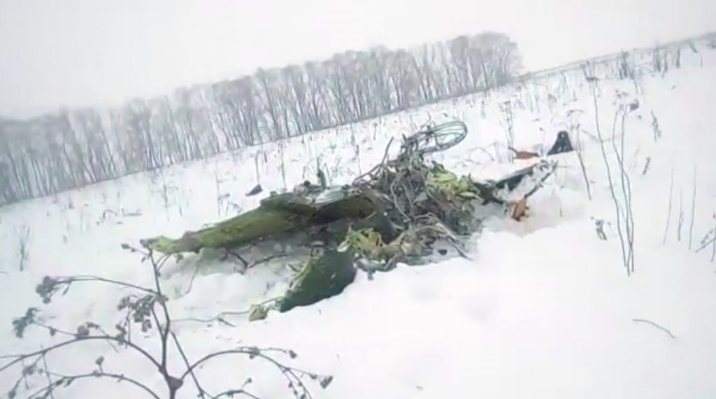 The wreckage of an An-148 plane is seen in Stepanovskoye village, about 25 miles from the Domodedovo airport in Russia on Sunday. Russia's Emergencies Ministry said the passenger plane crashed near Moscow, killing all 71 people aboard.