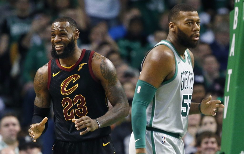 Cleveland's LeBron James reacts to a call as Boston's Greg Monroe turns away during the Celtics' 121-99 loss on Sunday in Boston.