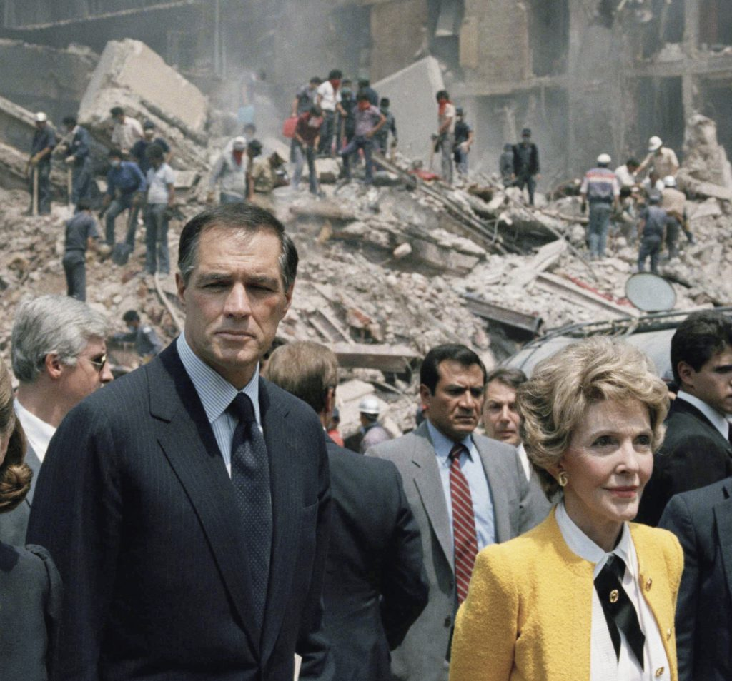 First lady Nancy Reagan and U.S. Ambassador to Mexico John Gavin, left, view earthquake damage in Mexico City in this 1985 photo. Gavin died Friday at 86.