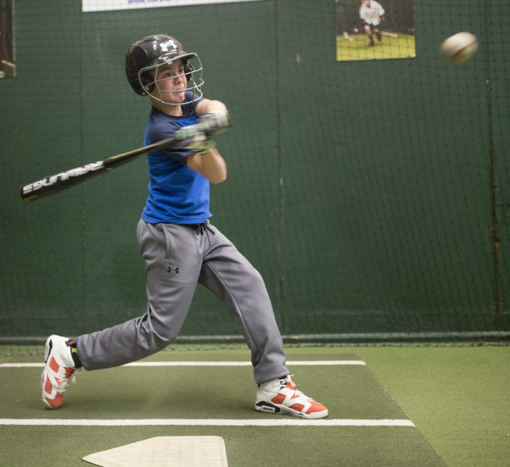 Thomas Lewis, 12, hits in the batting cage at the Westbrook Community Center during practice with his Little League team, which is using the new baseball bats mandated for youth baseball leagues.