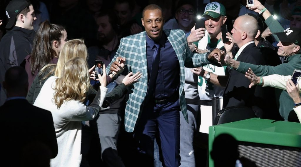 Though it was a blazer instead of a uniform, Paul Pierce still wore green Sunday while coming onto the court for a ceremony to retire his No. 34. Current and past members of the Celtics were among those who joined the crowd in the tribute.