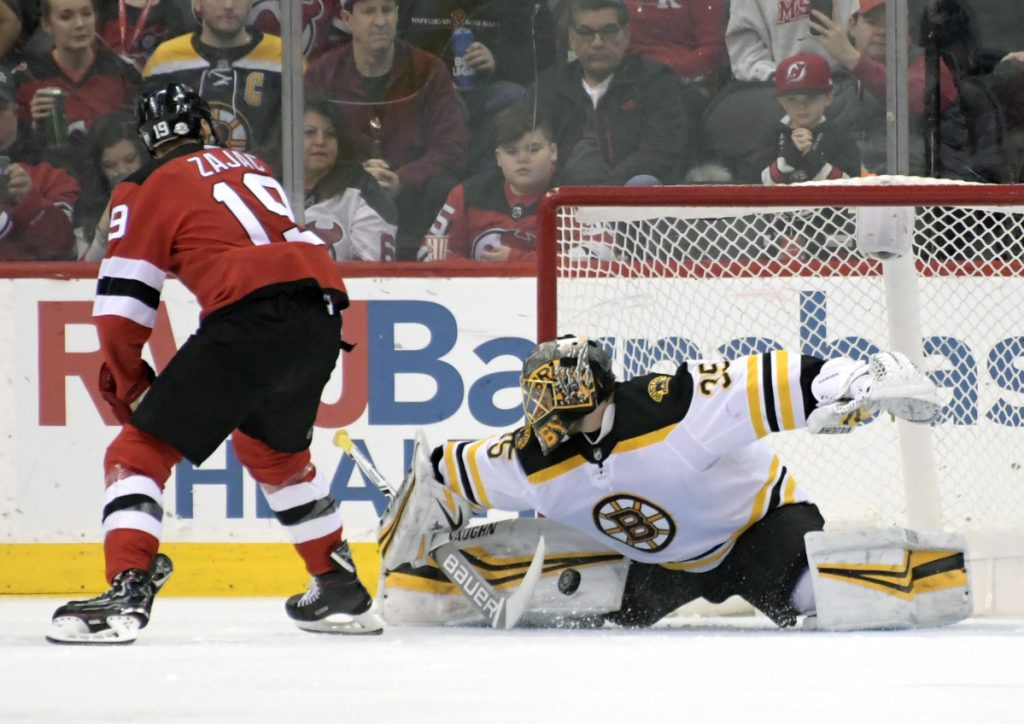 Goaltender Anton Khudobin of the Boston Bruins makes a save on a penalty shot by Travis Zajac of the New Jersey Devils in the first period of the Bruins' 5-3 victory Sunday night.