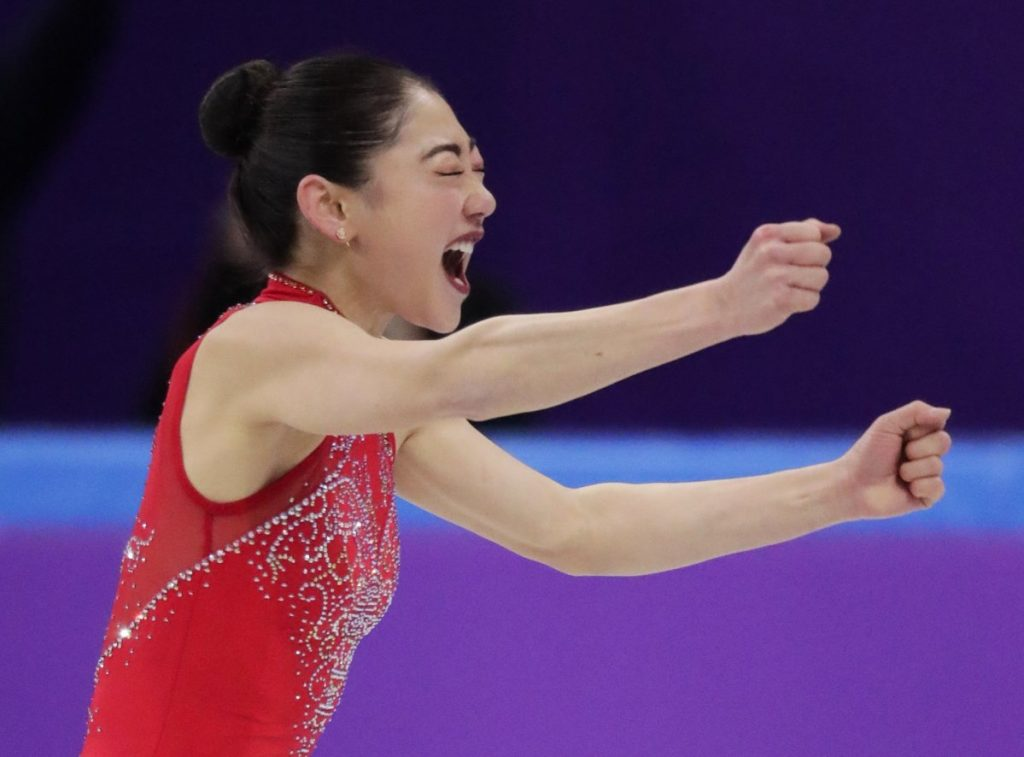 Mirai Nagasu of the United States reacts after she landed a triple axel.