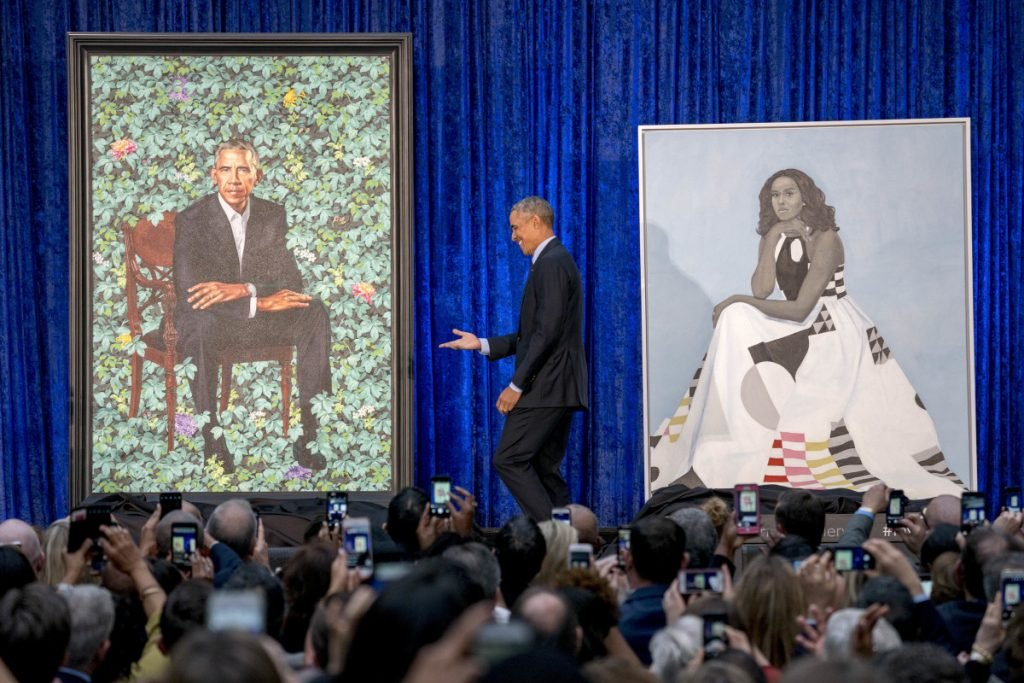 Former President Barack Obama takes the stage during the unveiling of the official Obama portraits at the Smithsonian's National Portrait Gallery on Monday in Washington.