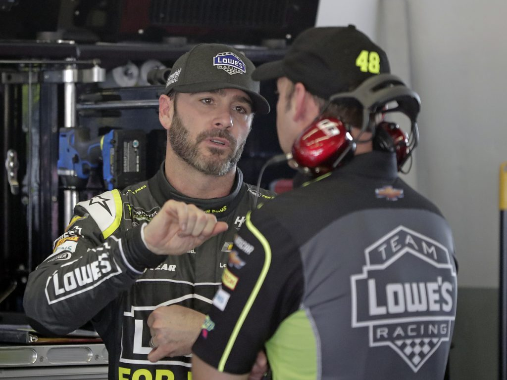 Jimmie Johnson, left, with crew chief Chad Knaus, signed a three-year extension with Hendrick Motorsports and sees no reason why he can't win a title each of those three seasons.