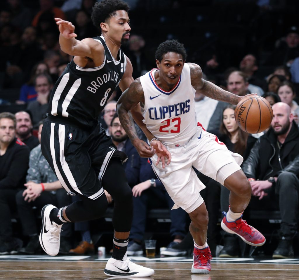 Clippers guard Lou Williams tries to drive past Nets guard Spencer Dinwiddie during the Clippers' 114-101 win Monday in New York. Williams scored 20 points off the bench.