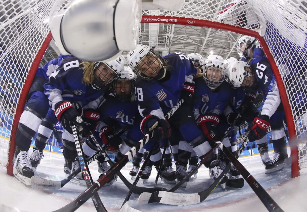 Players from the United States pose fas they gather around the goal before their women's hockey game against the team from Russia at the 2018 Winter Olympics on Tuesday. ()