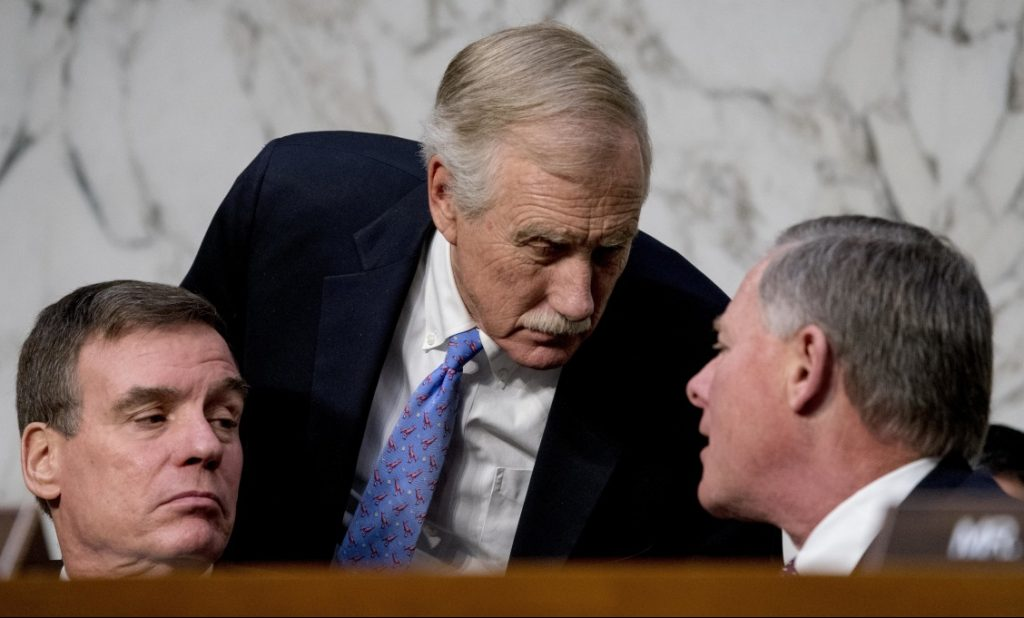 From left, Vice Chairman Mark Warner, D-Va., Sen. Angus King, I-Maine, and Chairman Richard Burr, R-N.C., speak together during a Senate Select Committee on Intelligence hearing on worldwide threats on Tuesday in Washington.