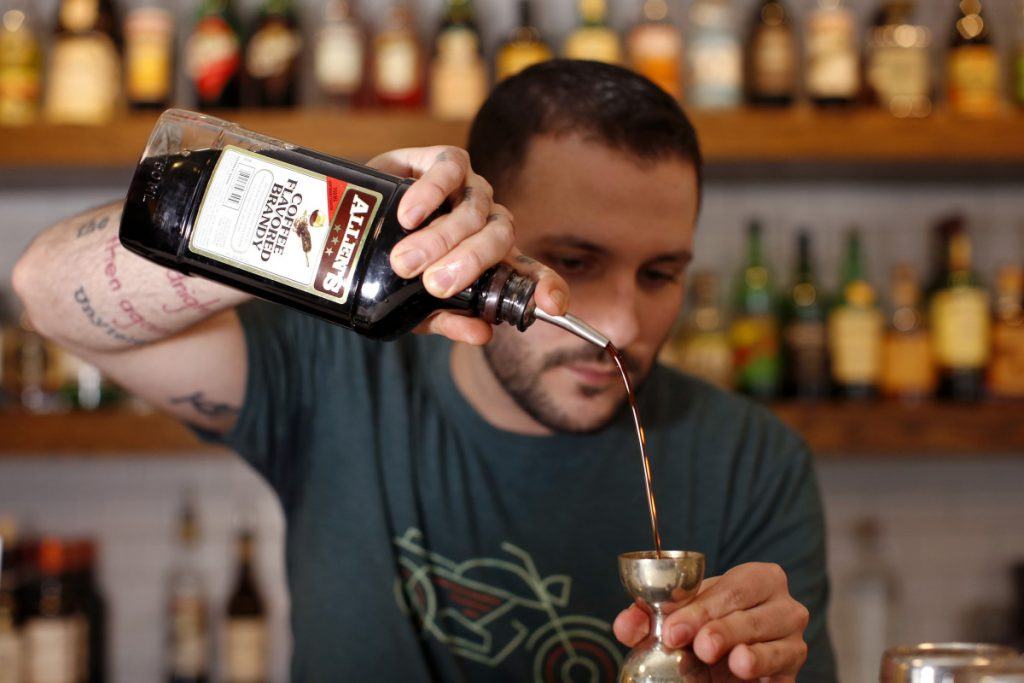 "Jaren Rivas makes what he calls a ""Woo Carré"" – a riff on a New Orleans specialty, the Vieux Carré – with Allen's Coffee Flavored Brandy, rum, sweet vermouth, bitters and more."