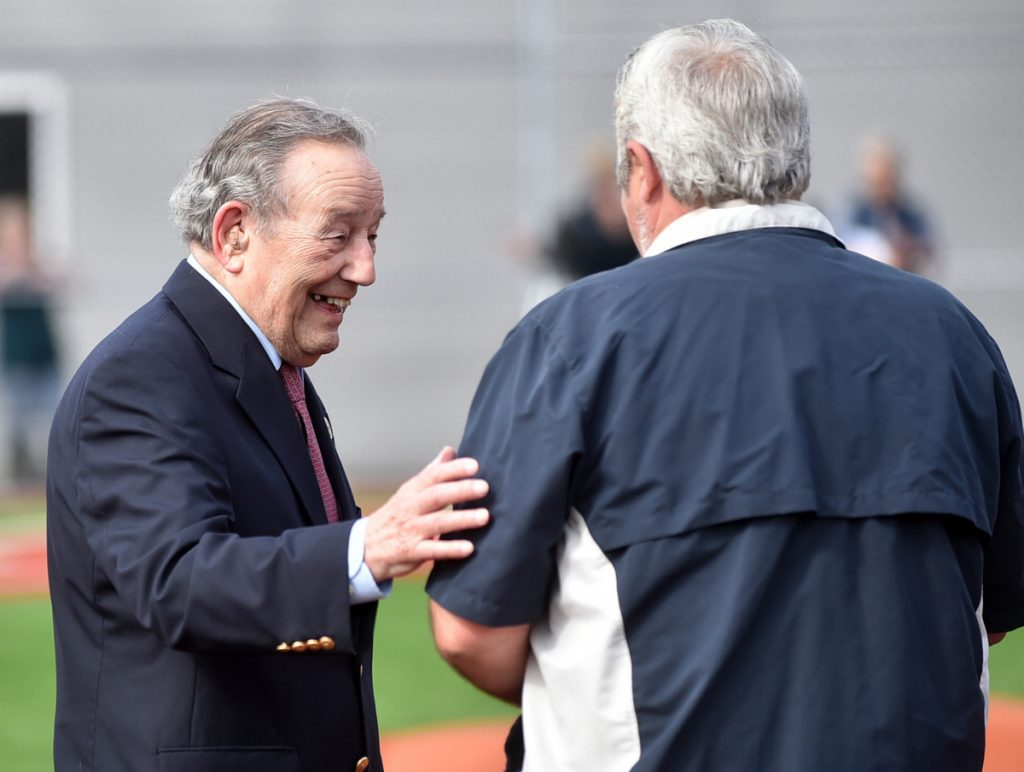Paul Mitchell greets people after being introduced during the dedication of Purnell Wrigley Field in Waterville on April 29, 2017. The third base side dugout is named after him.