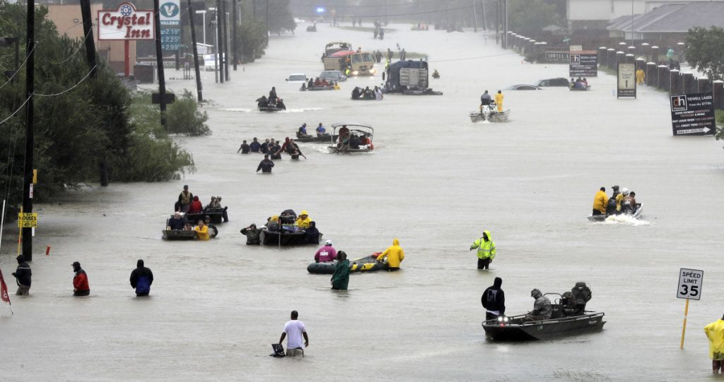 Rescue boats ferry Houston residents to higher ground during Hurricane Harvey last year. A new study suggests the sea level could be rising faster than scientists believed, and could worsen the impact of coastal storms, like Harvey.