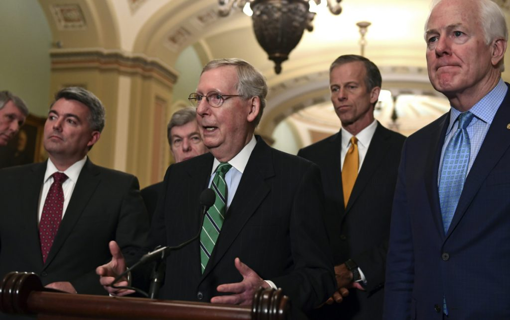 Senate Majority Leader Mitch McConnell of Ky., center, with other members of his party at the Capitol on Tuesday, discusses prospects for agreement on an immigration bill.