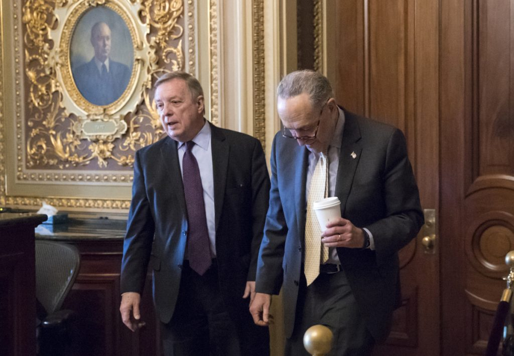 """Sen. Dick Durbin, D-Ill., left, and Senate Minority Leader Chuck Schumer, D-N.Y., walk together outside the chamber during debate in the Senate on immigration, at the Capitol in Washington on Wednesday. Schumer said on the Senate floor that """"the one person who seems most intent on not getting a deal is President Trump."""""""