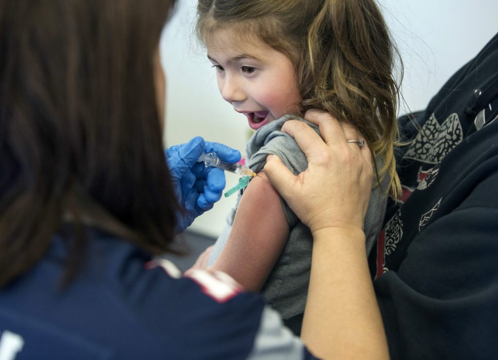 Angel Van Deventer, 5, of South Portland reacts as she gets a flu shot at a clinic hosted Feb. 2 by VNA Home Health Hospice.