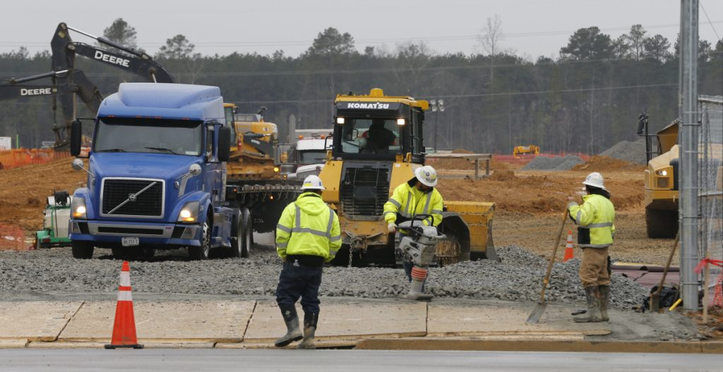 Workers prepare a construction entrance to the Facebook data center that is being built in Sandston, Va., a state that provides incentives for such massive, high-tech operations.