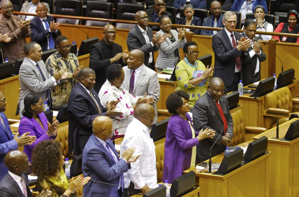 Cyril Ramaphosa, front right, is cheered by Parliament after being elected President in Parliament in Cape Town, South Africa.