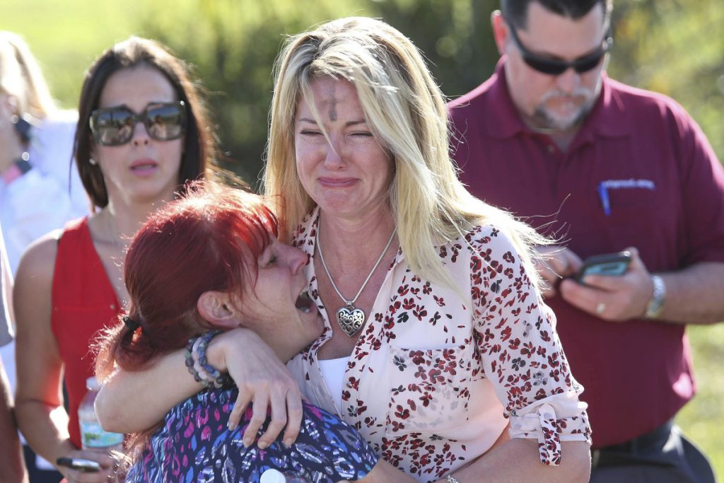 Distraught parents wait for news Wednesday outside Marjory Stoneman Douglas High School in Parkland, Fla., where 17 people were killed in one of the nation's most deadly school shootings. Among high-income nations, 91 percent of the children under age 15 who have been shot to death are American.