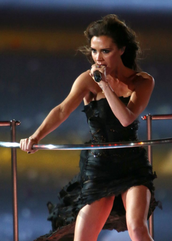 Victoria Beckham (Posh Spice) performs with the Spice Girls during the closing ceremony at the 2012 Summer Olympics.