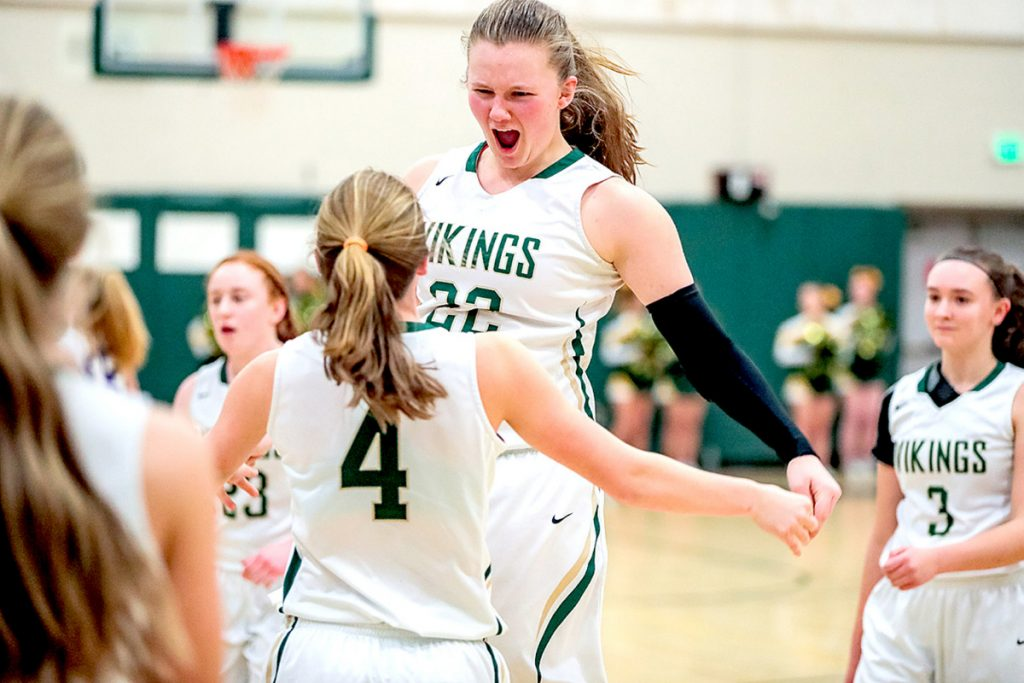 Oxford Hills junior Jadah Adams, right, celebrates with Emily Corbett after the Vikings defeated Deering 55-40 in Paris on Thursday.
