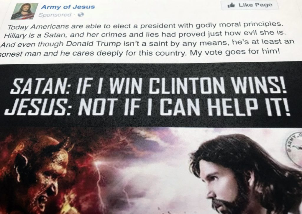 "A Facebook ad linked to a Russian effort to disrupt the American political process and stir up tensions around divisive social issues, released by the U.S. House Intelligence Committee, is photographed in Washington, on Friday, Feb. 16, 2018. The ad, with the words ""Hillary is a Satan, and her crimes and lies had proved just how evil she is"" was listed as an excerpt of political advertising in the indictment charging 13 Russians and three Russian entities in an elaborate plot to interfere in the 2016 U.S. presidential election (AP Photo/Jon Elswick)"