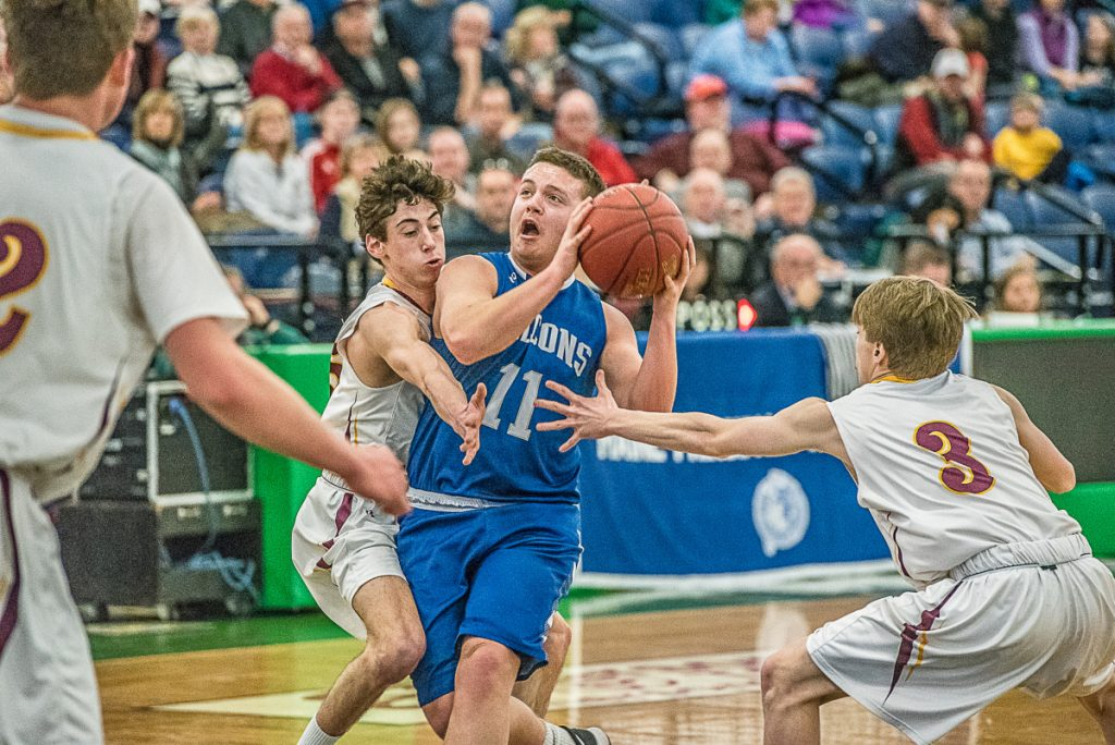 Mountain Valley's Michael Pare takes a shot as Liam Jacobson and Nathan Mullen of Cape Elizabeth play defense during Saturday's game at the Portland Expo. Cape Elizabeth won the game, 47-31.