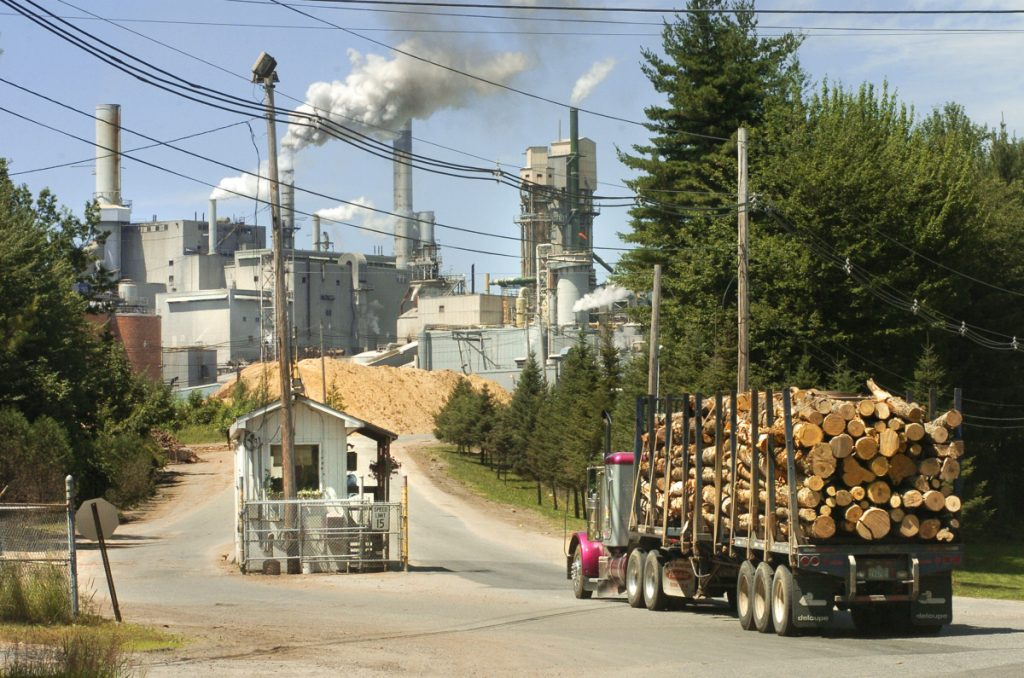 A truck loaded with logs enters the International Paper's Androscoggin Mill in Jay in 2005. Staff file photo by John Ewing