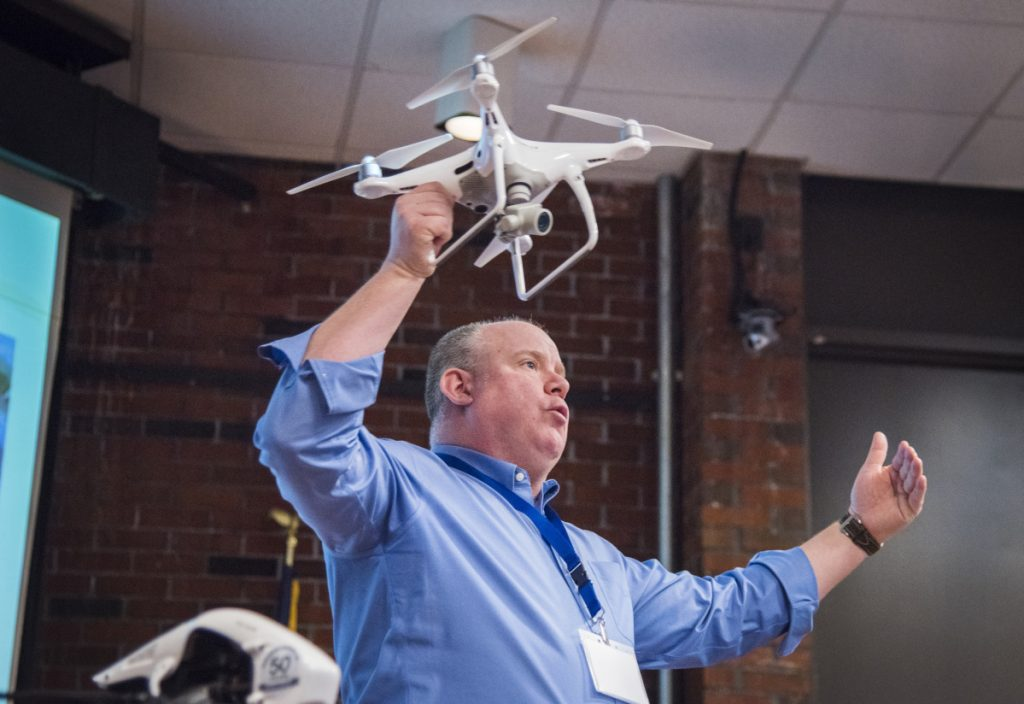 David Price, of the Association of Professional Drone Pilots, presents at the first drone business applications conference at the University of Maine in Augusta.