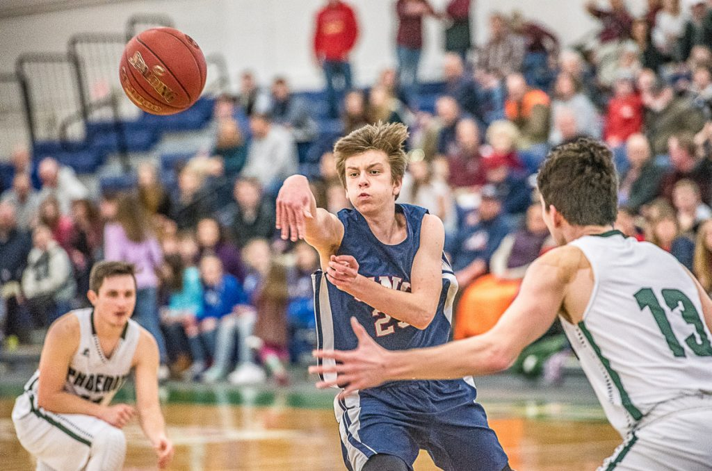 Zack Pomerleau, who hit three 3-pointers and finished with 12 points for Gray-New Gloucester, finds room to pass between Mason Shink, left, and Nick Lombardi of Spruce Mountain during Gray-New Gloucester's 57-34 victory Saturday in a Class B South quarterfinal at the Portland Expo.