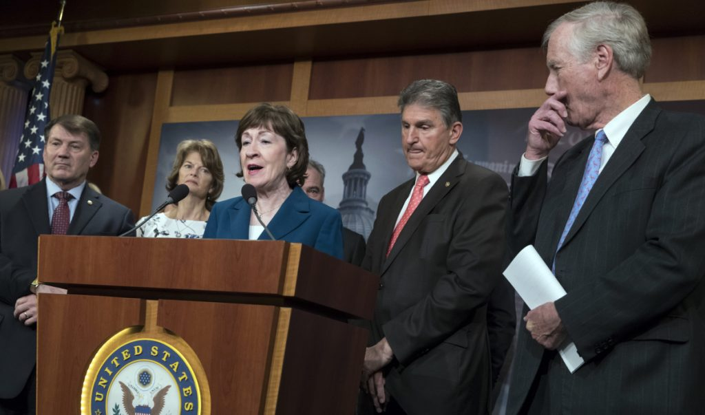 "On Thursday, Sen. Susan Collins, R-Maine, was joined by other members of the ""common sense coalition,"" from left, Sen. Mike Rounds, R-S.D., Sen. Lisa Murkowski, R-Alaska, Sen. Joe Manchin, D-W.Va., and Sen. Angus King, I-Maine, to discuss a bipartisan immigration deal, even as President Trump was already moving against it."
