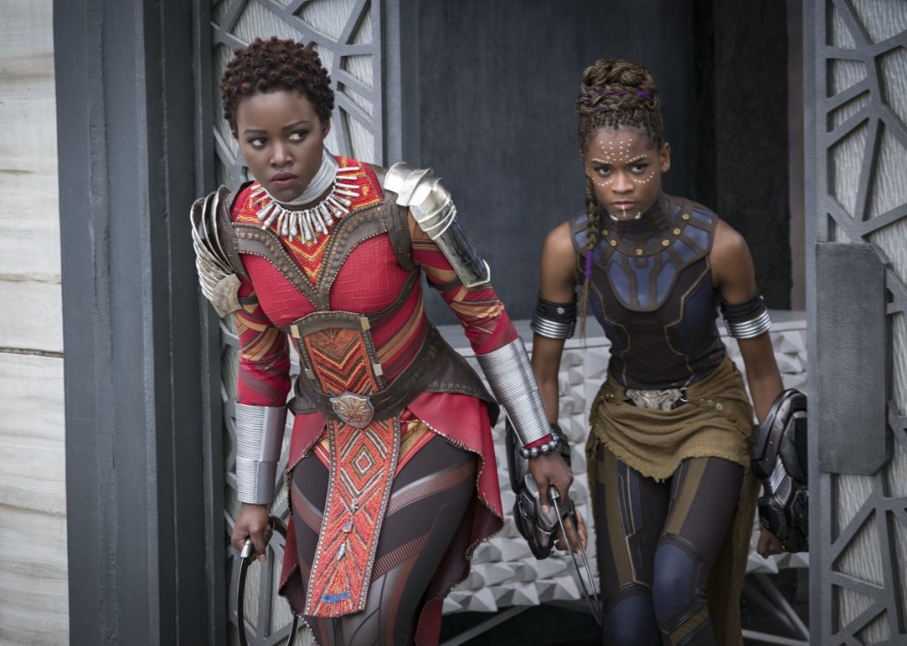 "Lupita Nyong'o, left, and Letitia Wright in a scene from Marvel Studios' ""Black Panther."""