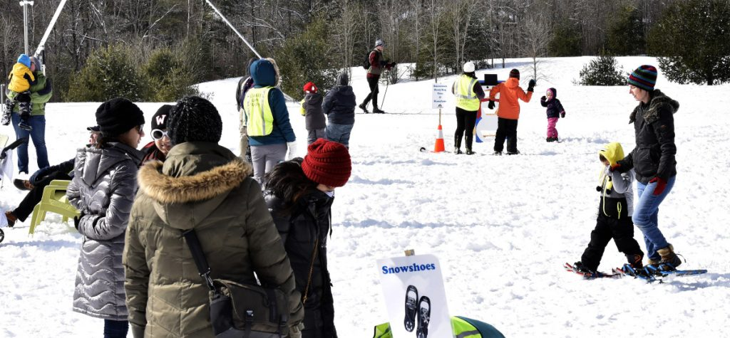 Families try cross-country skiing, snowshoes, sledding and games during the Winter Fun Day at the Quarry Road Recreation Area in Waterville on Sunday.