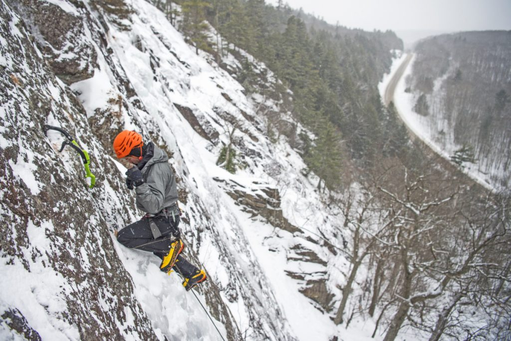 Ryan Howes reaches the top at Barrett's Cove in Camden Hills State Park on Jan. 8.