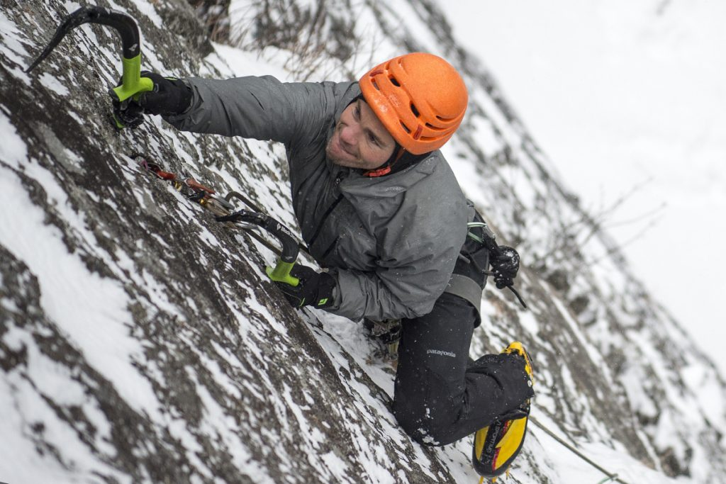 Ryan Howes uses ice tools to climb a cliff at Barrett's Cove in Camden Hills State Park on Jan. 8. The Augusta native has been climbing in Camden for the past 17 years.